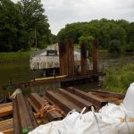 Sheet piling being installed for coffer dam