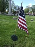 Memorial marker with flag